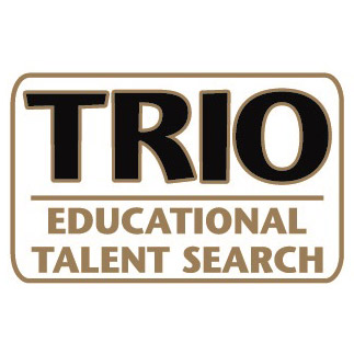 """All Caps sample of TRIO ETS pin. 1"""" x 5/8"""" Die Struck Lapel Pin.  Bright Goldtone Finish.  Black and White Soft Enamel Colorfill."""