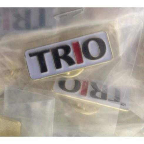 """TRO"" capital letters in black, with ""I"" in red. 1"" x ~ 1/2"" Die Struck Lapel Pin Bright Goldtone Finish Black, White, Red (PMS 186c) Soft Enamel Colorfill. Individually polybagged"