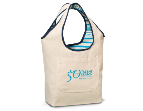 "Reversible tote with on-trend graphics for added interest Large main compartment Front slash pocket on non-patterned side 18"" shoulder straps"